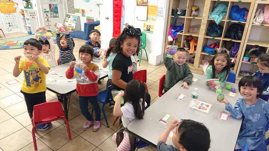 Young kids in the classroom having fun